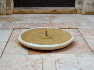 The Alcazar, Seville. Almost still water in a bowl.