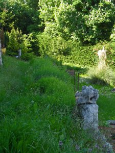 A garden in Tomaj.  Karst limestone used as sculpture, billowing mounds of grasses, winding pathways.